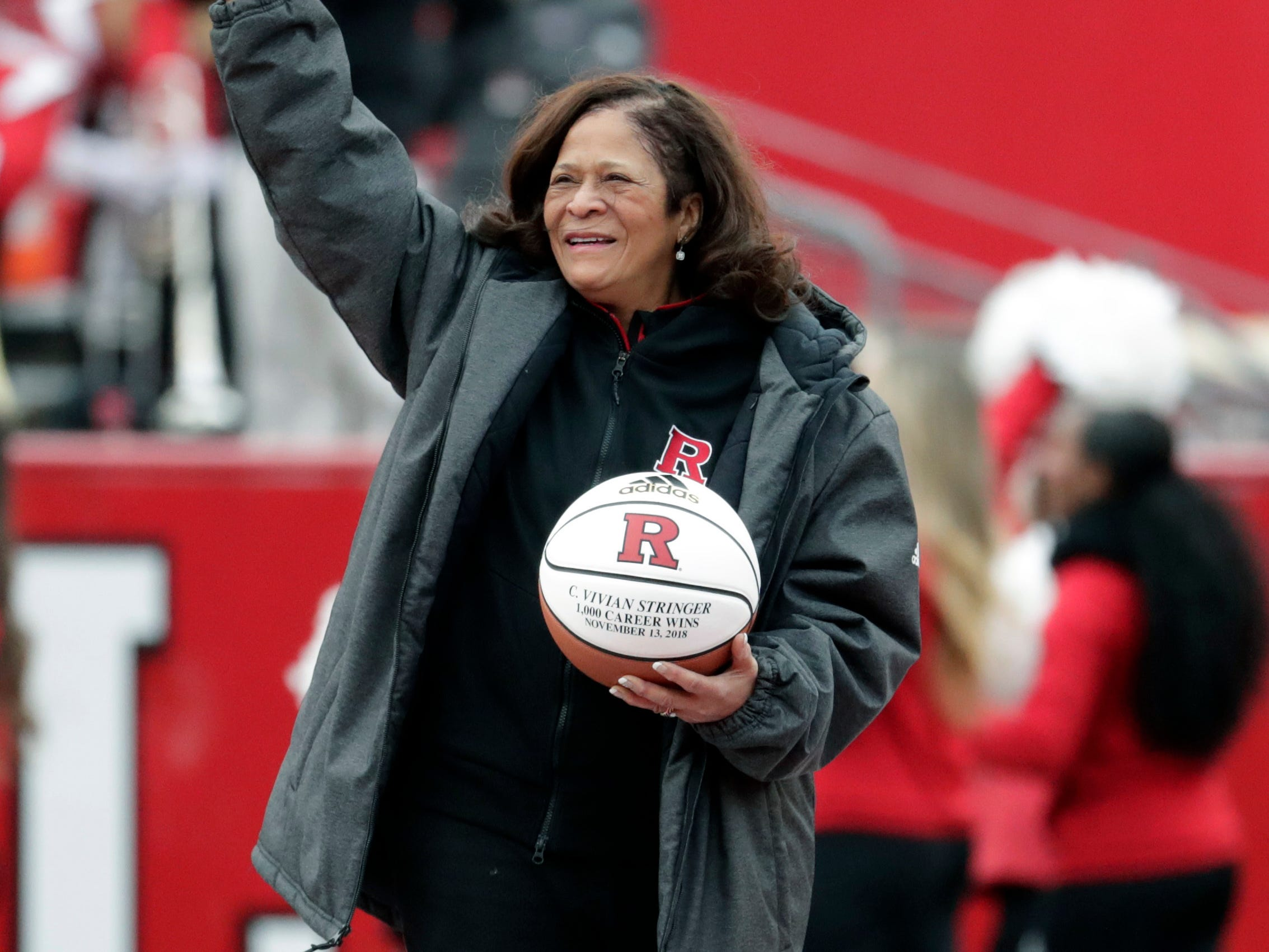 Rutgers women's basketball head coach C. Vivian Stringer is honored on the field during the first half of an NCAA college football game between Rutgers and Penn State, Saturday, Nov. 17, 2018, in Piscataway, N.J. Stringer recorded her 1,000th victory on Tuesday against Central Connecticut State. (AP Photo/Julio Cortez)