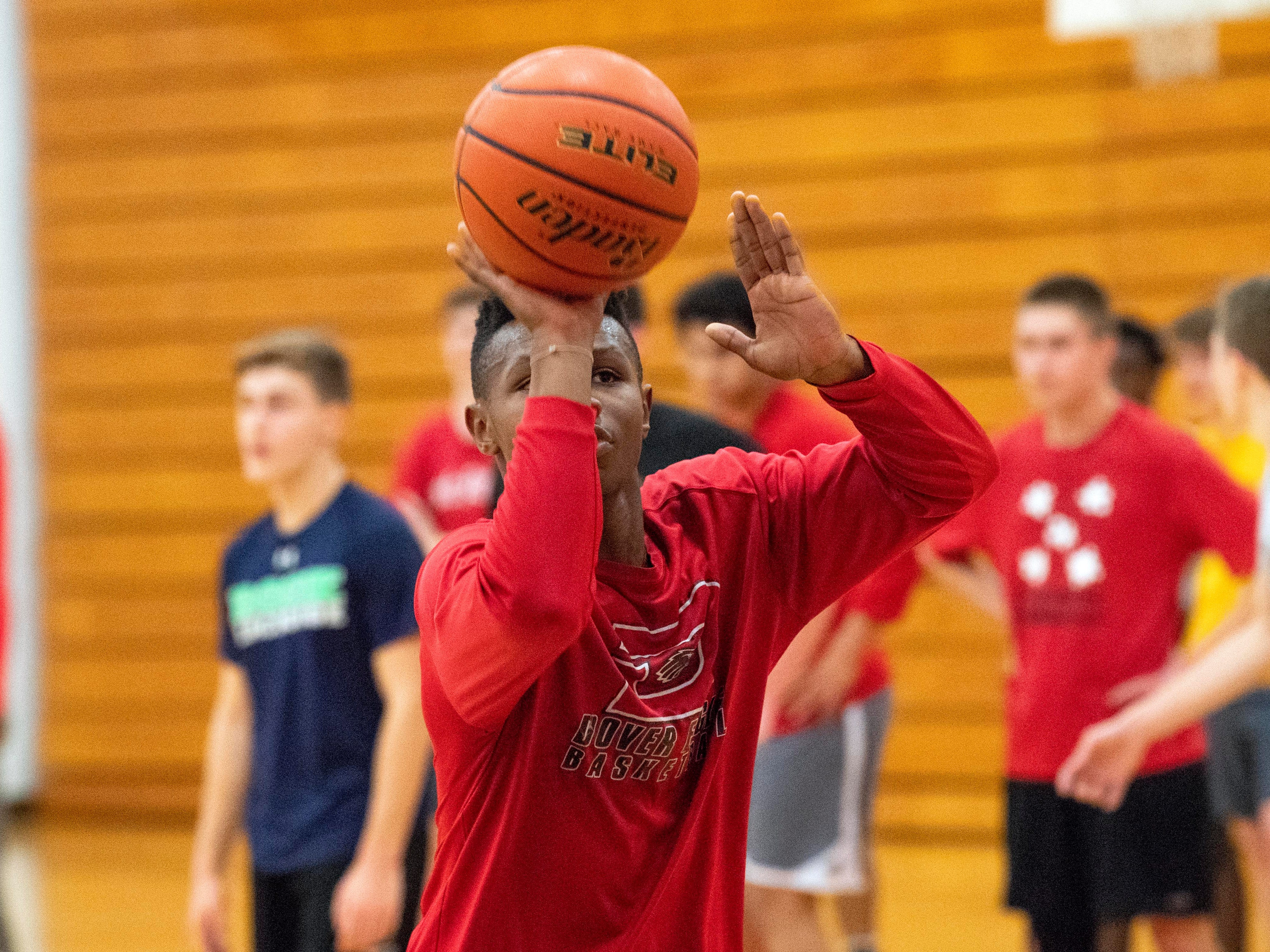 Dover boys' basketball practices shooting during the first official day of winter sports practice on Friday, November 16, 2018.