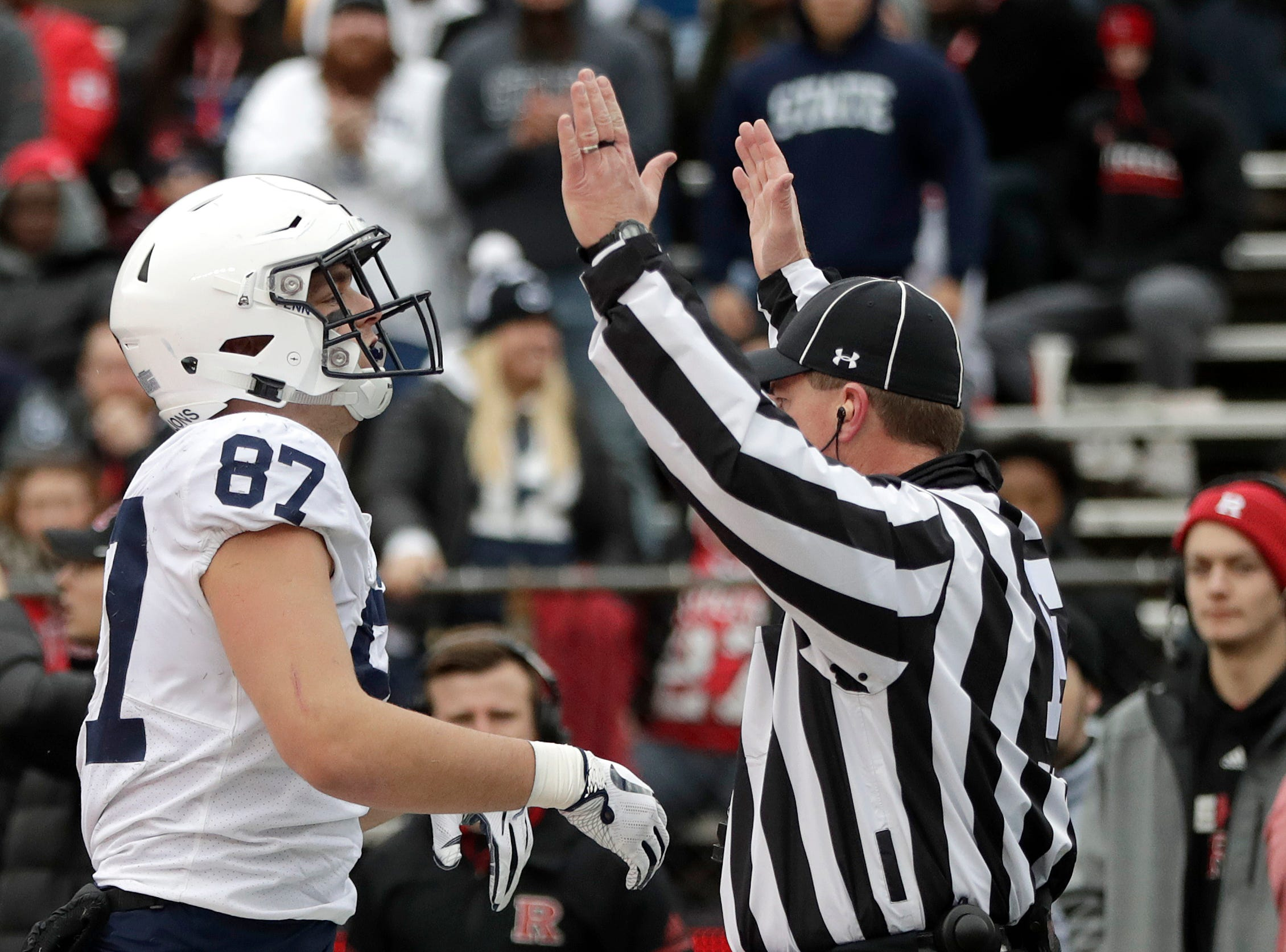 An official gestures touchdown after Penn State tight end Pat Freiermuth (87) caught a scoring pass from quarterback Trace McSorley, not pictured, during the first half of an NCAA college football game against Rutgers, Saturday, Nov. 17, 2018, in Piscataway, N.J. (AP Photo/Julio Cortez)