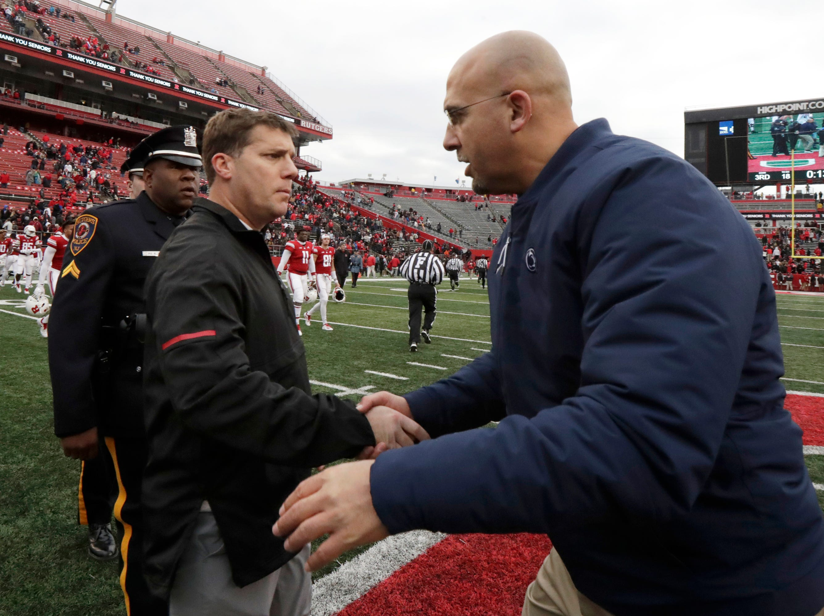 Rutgers head coach Chris Ash, left, shakes hands with Penn State head coach James Franklin after an NCAA college football game, Saturday, Nov. 17, 2018, in Piscataway, N.J. Penn State won 20-7. (AP Photo/Julio Cortez)