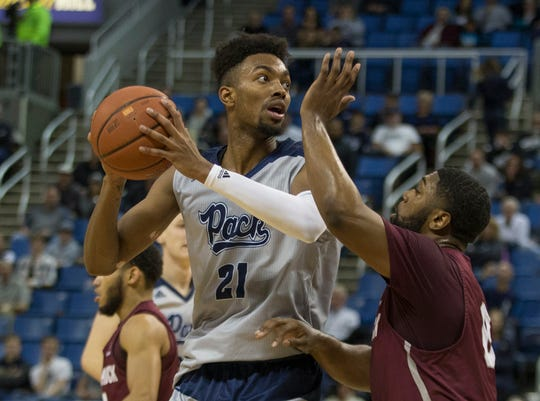 Nevada forward Jordan Brown looks to pass against Little Rock in a game earlier this month.