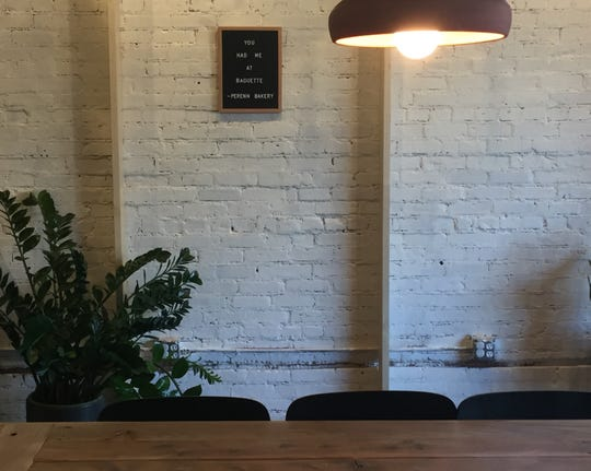 The new Perenn Bakery in Midtown Reno includes whitewashed brick walls and a communal table.