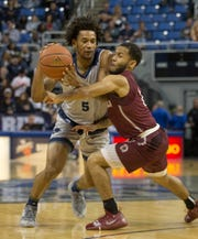 Nevada guard Nisre Zouzoua (5) is fouled by Little Rock's Markquis Nowell (1) in the second half of an NCAA college basketball game in Reno, Nev., Friday, Nov. 16.