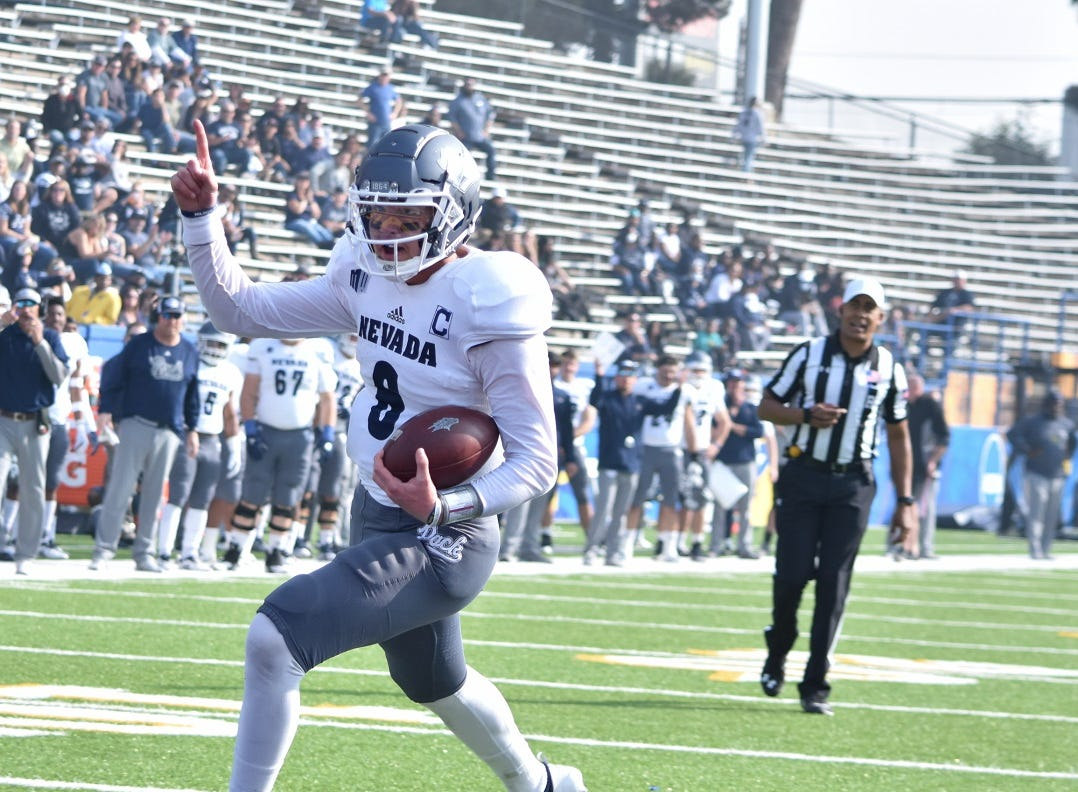 Nevada's Ty Gangi scores just before halftime on Saturday.