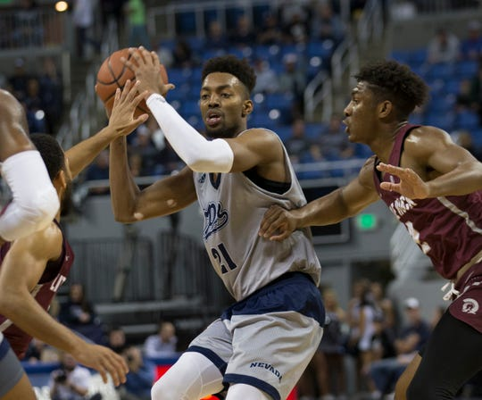 Nevada forward Jordan Brown (21) looks to pass the ball against Little Rock in the second half of an NCAA college basketball game in Reno, Nev., Friday, Nov. 16.