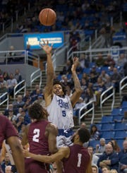 Nevada guard Nisre Zouzoua (5) takes a jump shot against Little Rock in the second half of an NCAA college basketball game in Reno, Nev., Friday, Nov. 16, 2018. Nevada won, 87-59.
