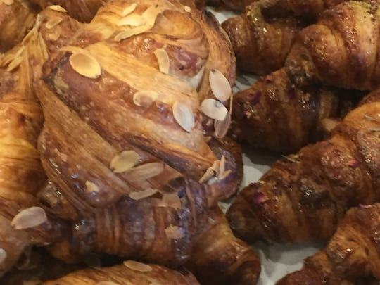 A jumble of almond and chocolate croissants at Perenn Bakery in Midtown Reno.