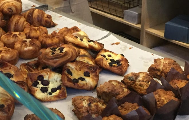 The front counter at Perenn Bakery in Midtown Reno overflows with kouign amann, blueberry danishes and other pastries on opening morning, Nov. 17, 2018.