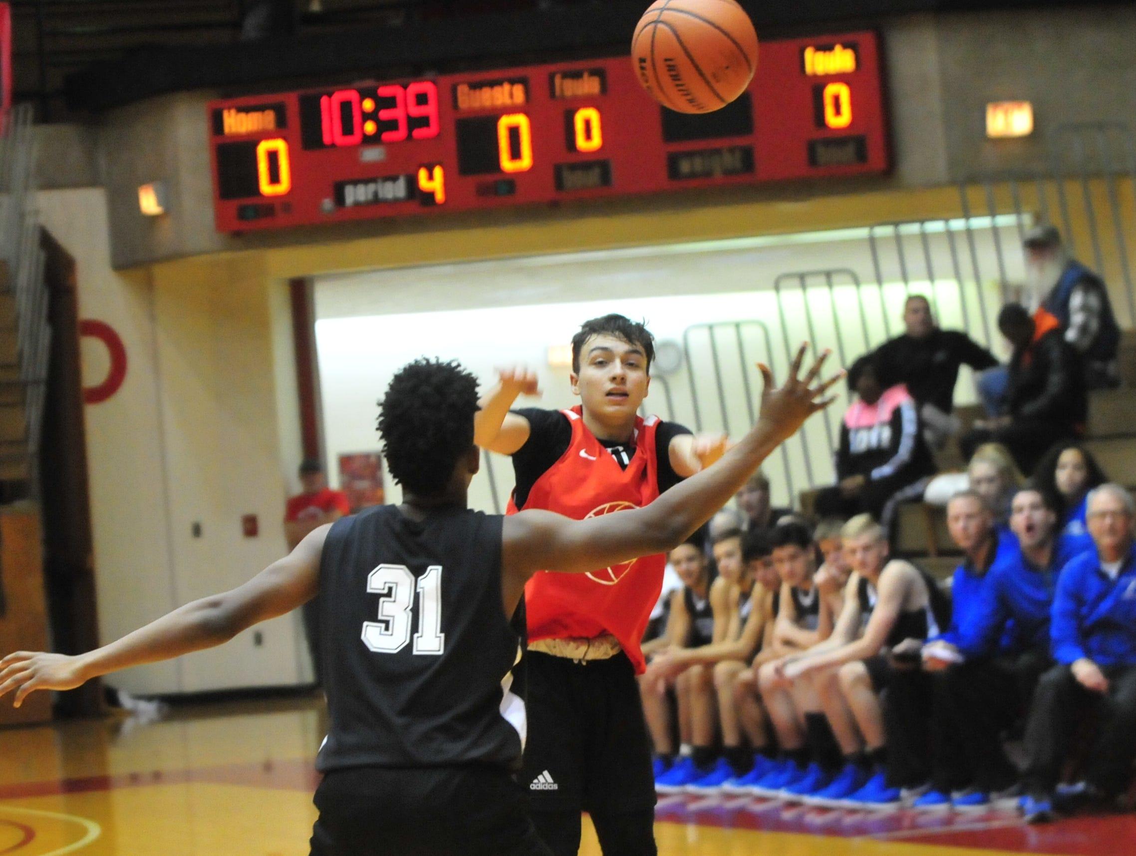 Richmond High School senior Jalen Hillard makes a pass during a boys basketball scrimmage against Franklin Central Saturday, Nov. 17, 2018 at Richmond High School's Tiernan Center.