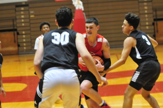 Richmond High School senior Lucas Kroft fights his way to the basket during a boys basketball scrimmage against Franklin Central Saturday, Nov. 17, 2018 at Richmond High School's Tiernan Center.
