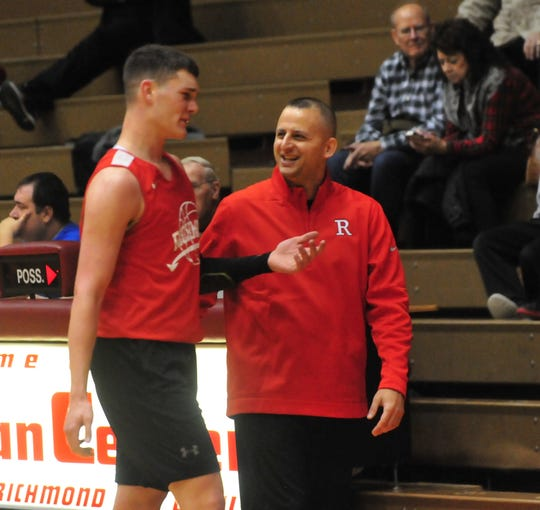 Richmond High School head coach Shabaz Khaliq smiles with senior Lucas Kroft  during a boys basketball scrimmage against Franklin Central Saturday, Nov. 17, 2018 at Richmond High School's Tiernan Center.