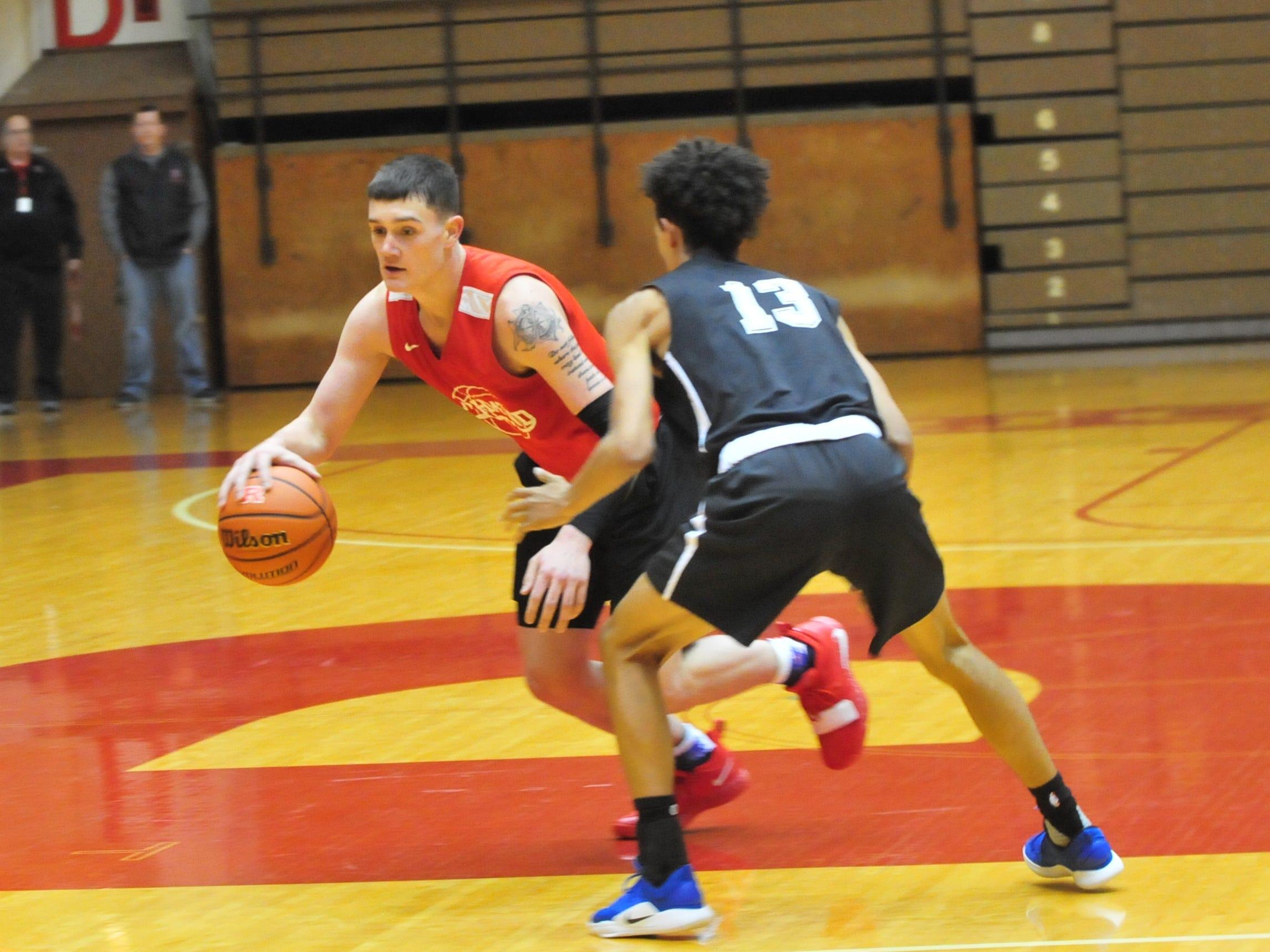 Richmond High School senior Lucas Kroft moves the ball during a boys basketball scrimmage against Franklin Central Saturday, Nov. 17, 2018 at Richmond High School's Tiernan Center.