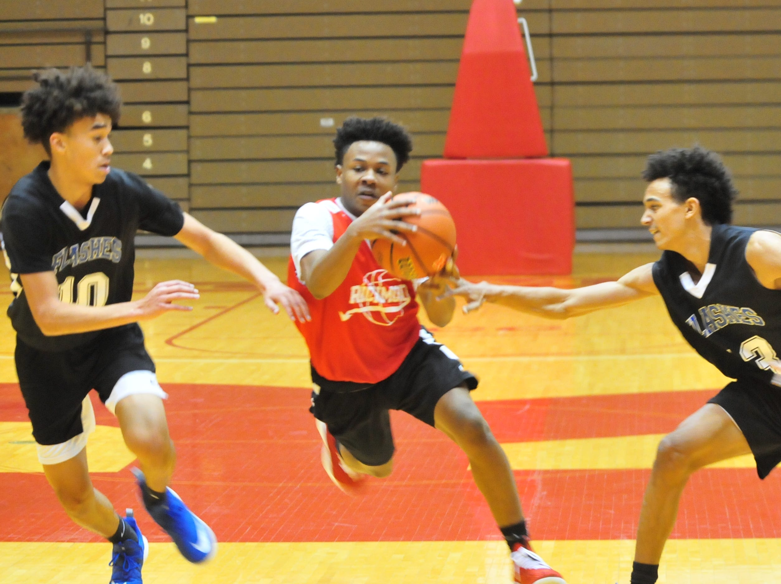 Richmond High School junior Koream Jett moves the ball during a boys basketball scrimmage against Franklin Central Saturday, Nov. 17, 2018 at Richmond High School's Tiernan Center.