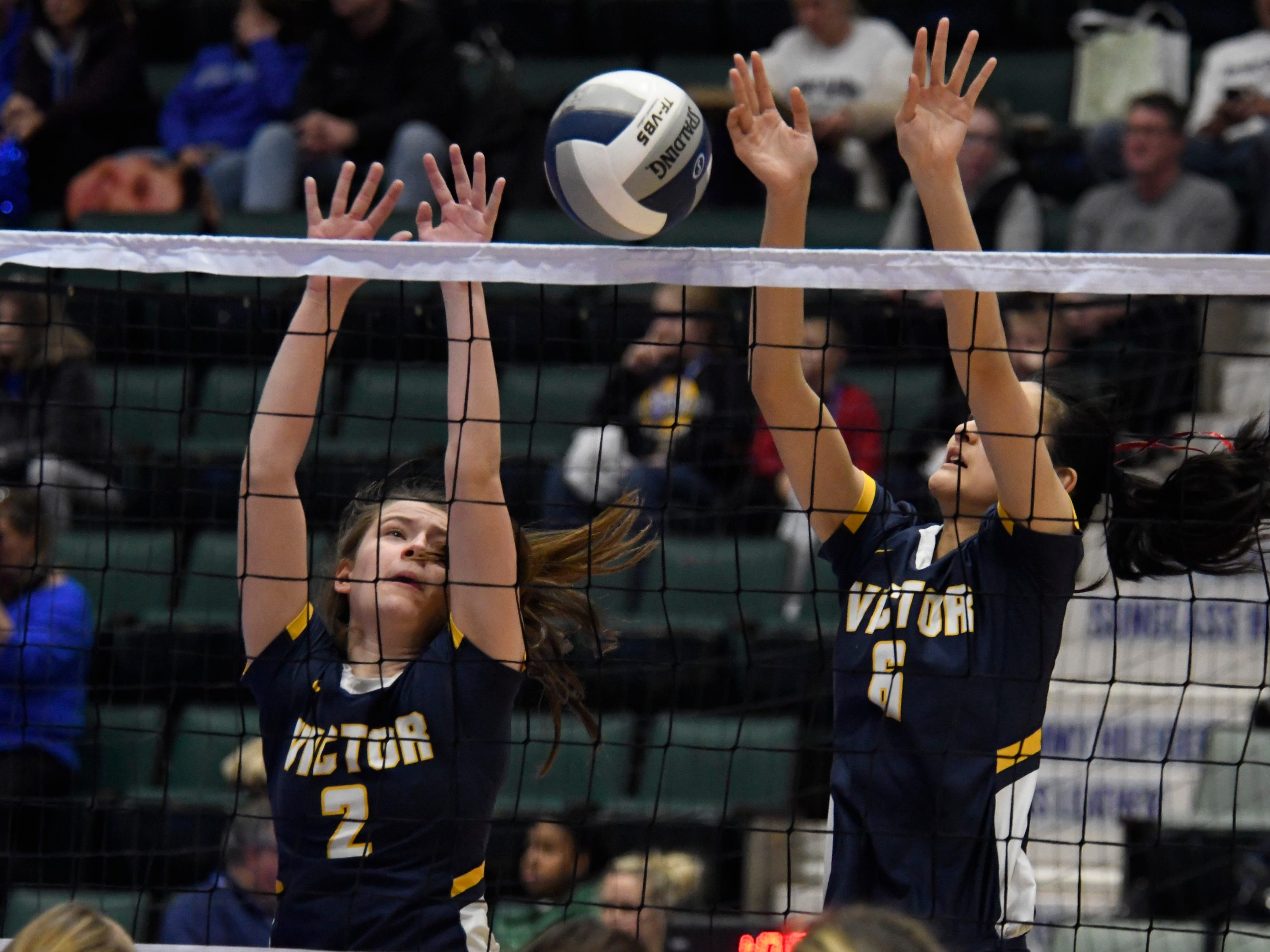 Victor's Ally Devitt (2) and Helen Qian jump to block the ball during a Class AA state semifinal pool game against Shenendehowa on Saturday, Nov. 17, 2018, at Cool Insuring Arena in Glens Falls.