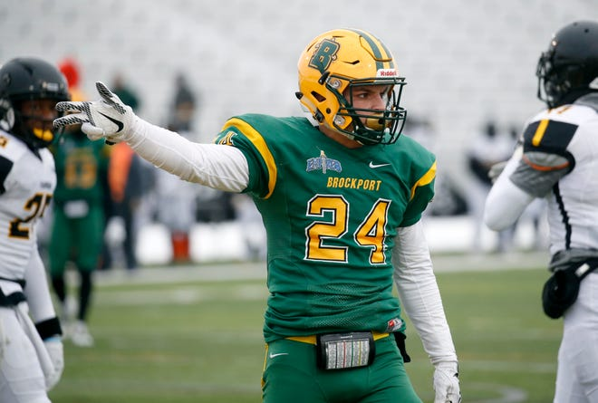 Brockport's Joseph Ortiz celebrates his catch that led to the Golden Eagles taking a 7-0 lead against Framingham in the first quarter at The College at Brockport.