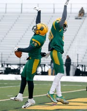 Brockport's Alex Benson celebrates his touchdown with DaQuan Hubbard to lead Framingham 21-0 in the second quarter at The College at Brockport.