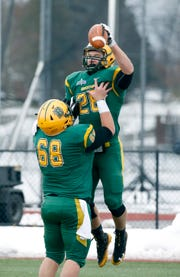 Brockport's Joe Benedict celebrates his touchdown with Mike Ambrosio for a play that gave the Golden Eagles a 14-0 lead against Framingham in the second quarter at The College at Brockport.