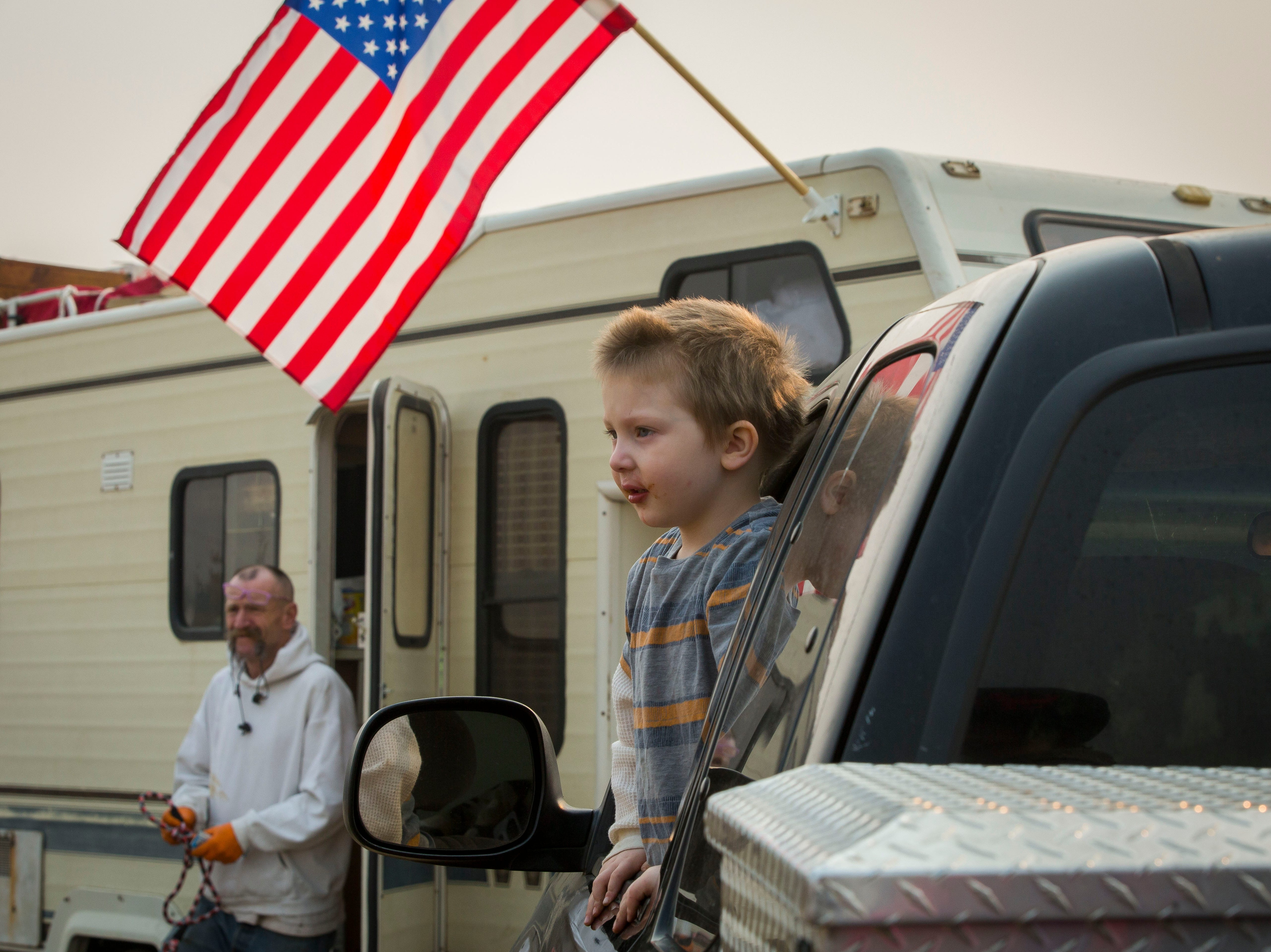 Bentley Belcher, 4, looks out of the window of the pick-up truck that has been loaned to his family as they camp at the Walmart in Chico, CA, Saturday Nov. 17, 2018. The Belcher family lost their home and vehicles to the Camp Fire.