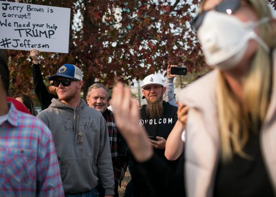 President Trump supporters and protesters clash moments after the President arrived at the Camp Fire Incident Command Center at the Silver Dollar Fair Grounds in Chico, California on Nov. 17, 2018.