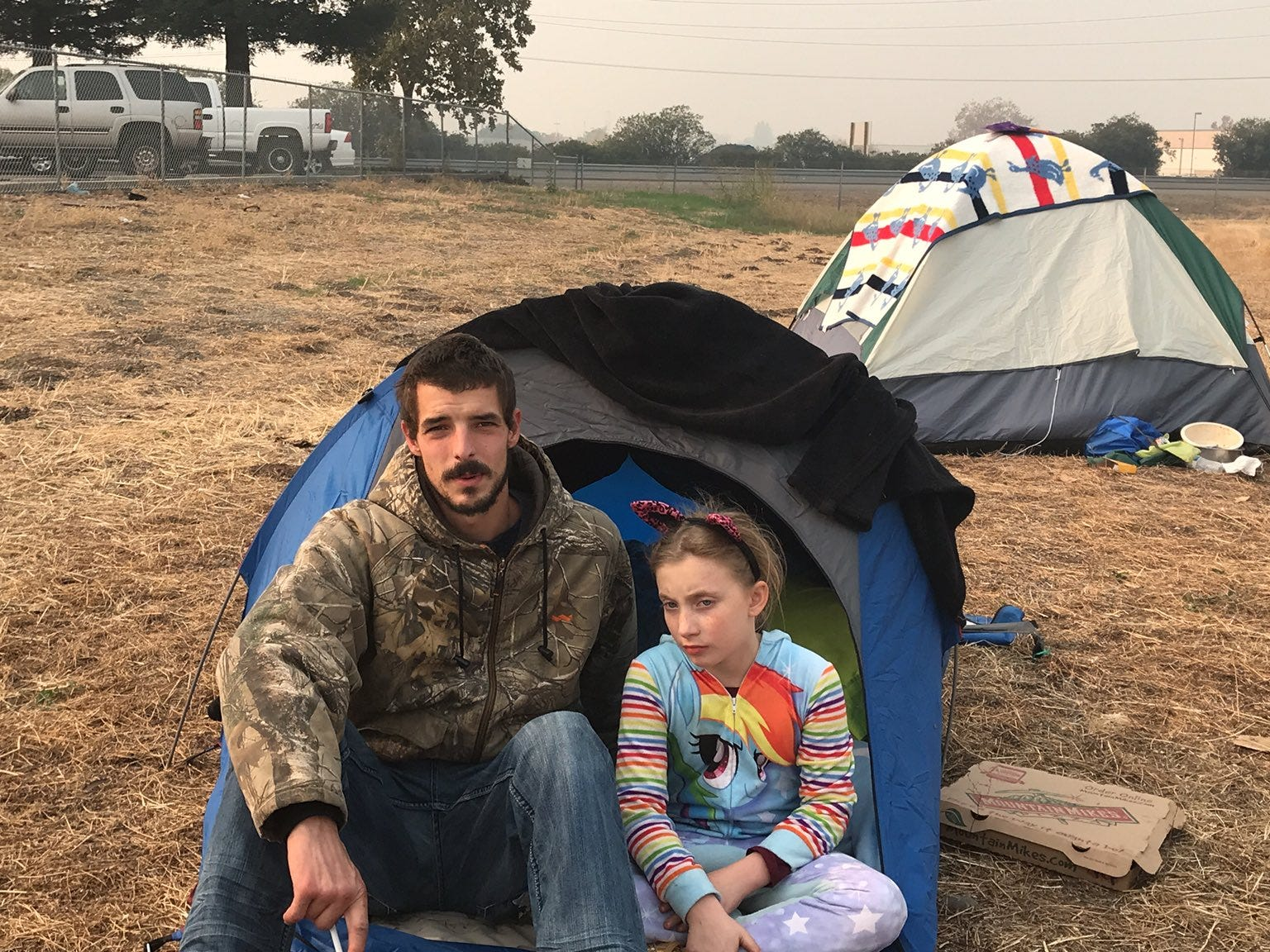 """The Belcher family lost their home in Paradise in the Camp Fire. They've been living in Ryan's boss' truck and a small tent. They have three kids ages 4 to 10. Zoeylee, 10, said kids are """"terrified."""" President Trump came to California on Saturday, Nov. 17, 2018 to see the devastation first-hand."""