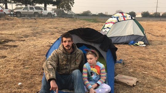 "The Belcher family lost their home in Paradise in the Camp Fire. They've been living in Ryan's boss' truck and a small tent. They have three kids ages 4 to 10. Zoeylee, 10, said kids are ""terrified."" President Trump came to California on Saturday, Nov. 17, 2018 to see the devastation first-hand."