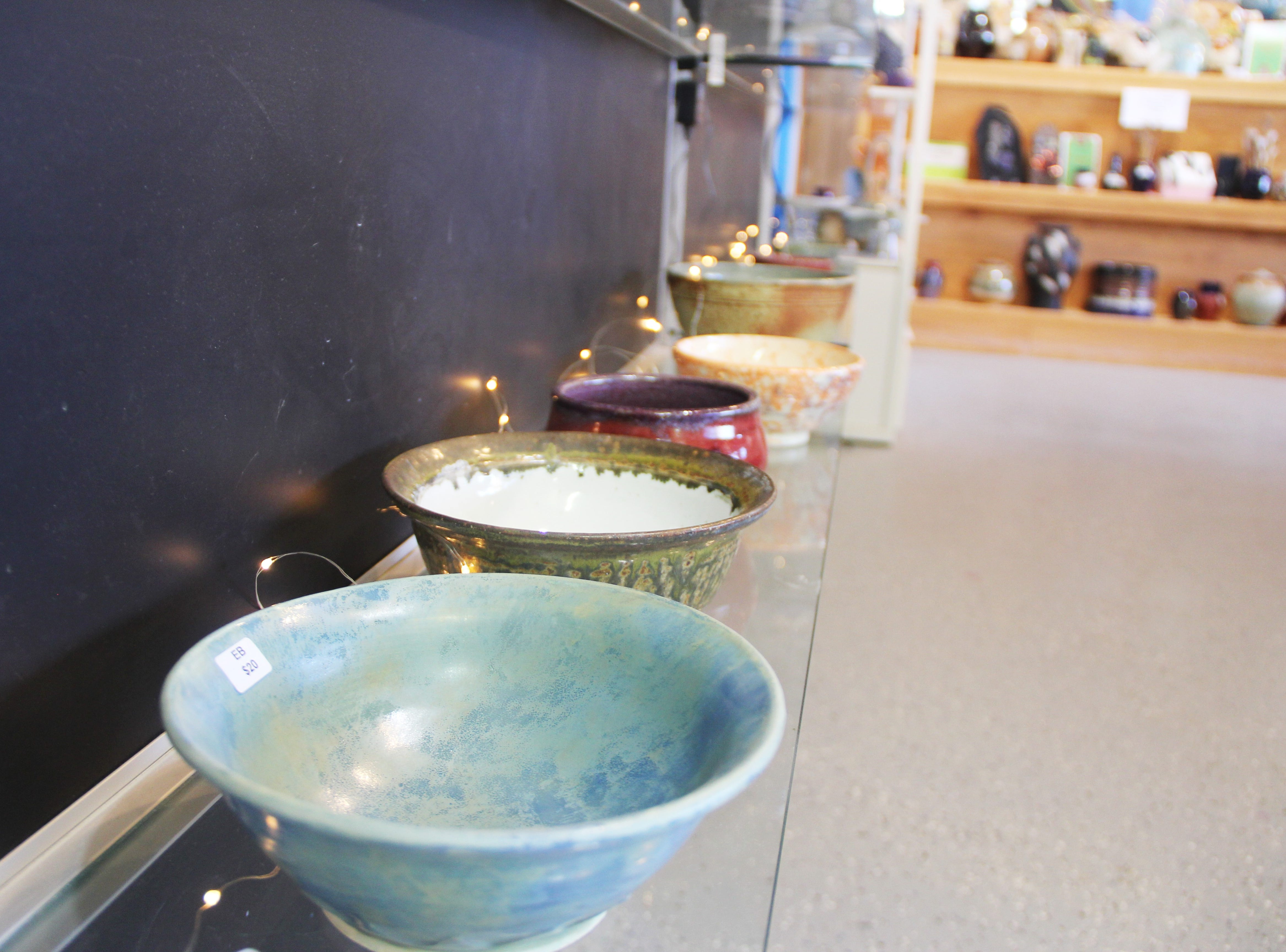 A row of bowls on the wall at the Willamette Art Center's Empty Bowls fundraiser on Saturday, Nov. 17. Since its inception in 2007, this fundraiser has raised more than $180,000 for the Marion-Polk Food Share.