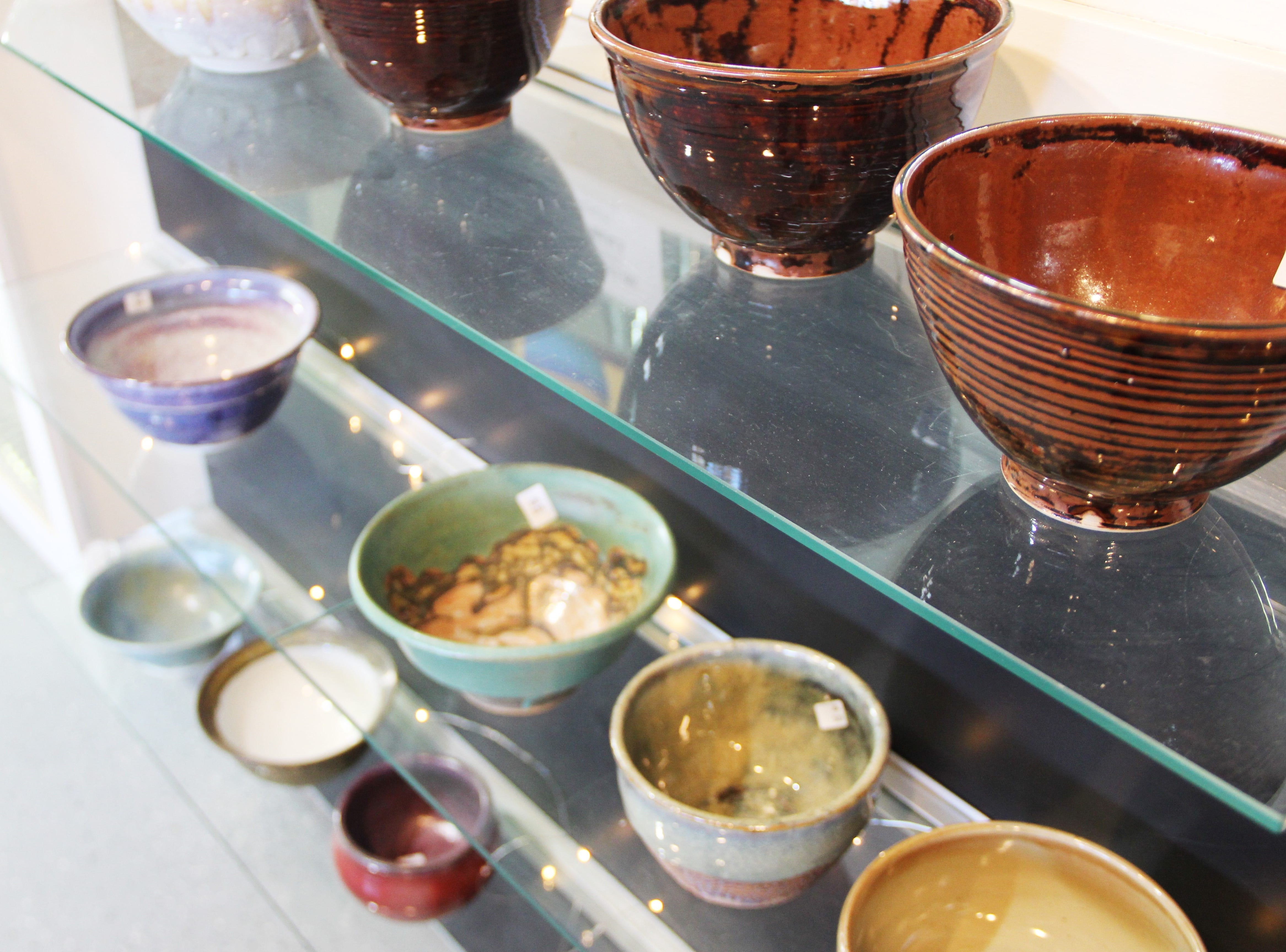 Rows of bowls at the Willamette Art Center's Empty Bowls fundraiser on Saturday, Nov. 17. Each bowl was created by volunteers.