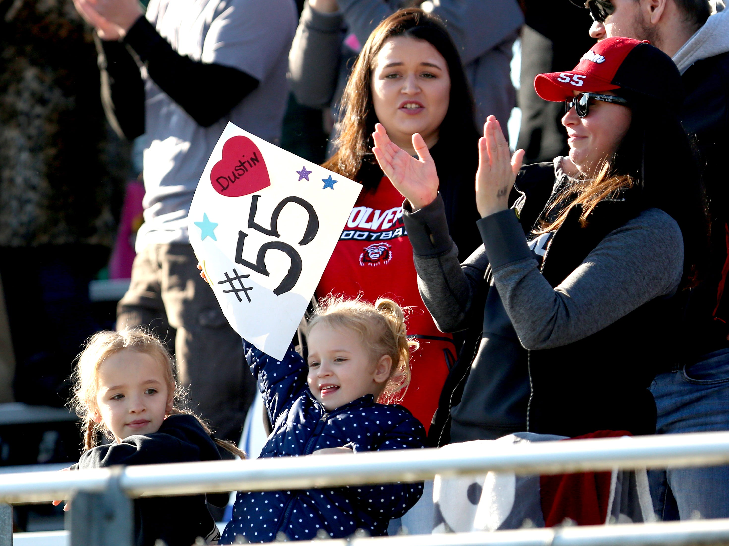 Supporter of Santiam's Dustin Keys (55) cheer him on during the OSAA 2A semifinal Santiam vs. Monroe football game on Saturday, Nov. 17, 2018 in Cottage Grove.