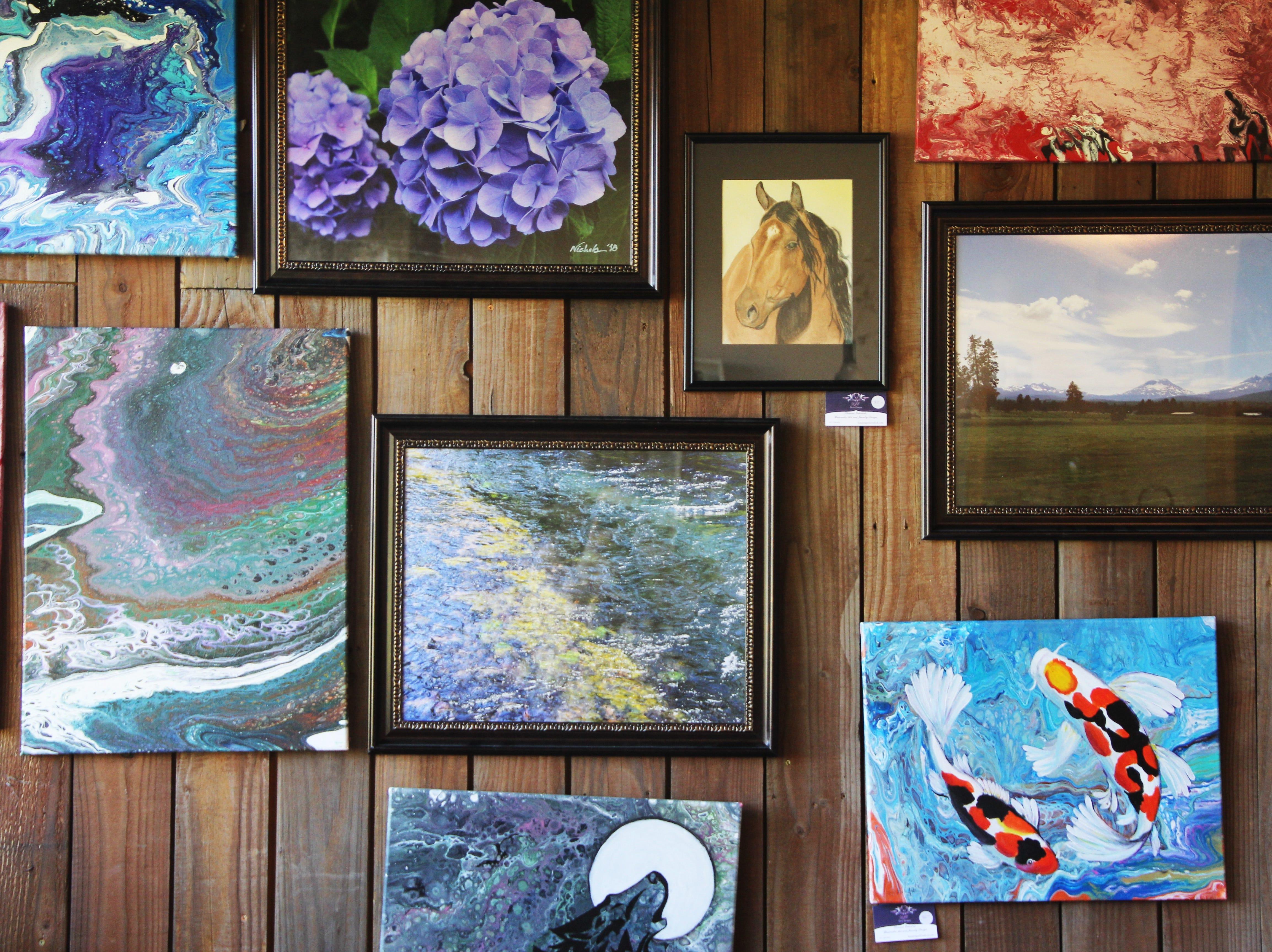 Framed art hung on the walls at the Willamette Art Center's Empty Bowls fundraiser on Saturday, Nov. 17.