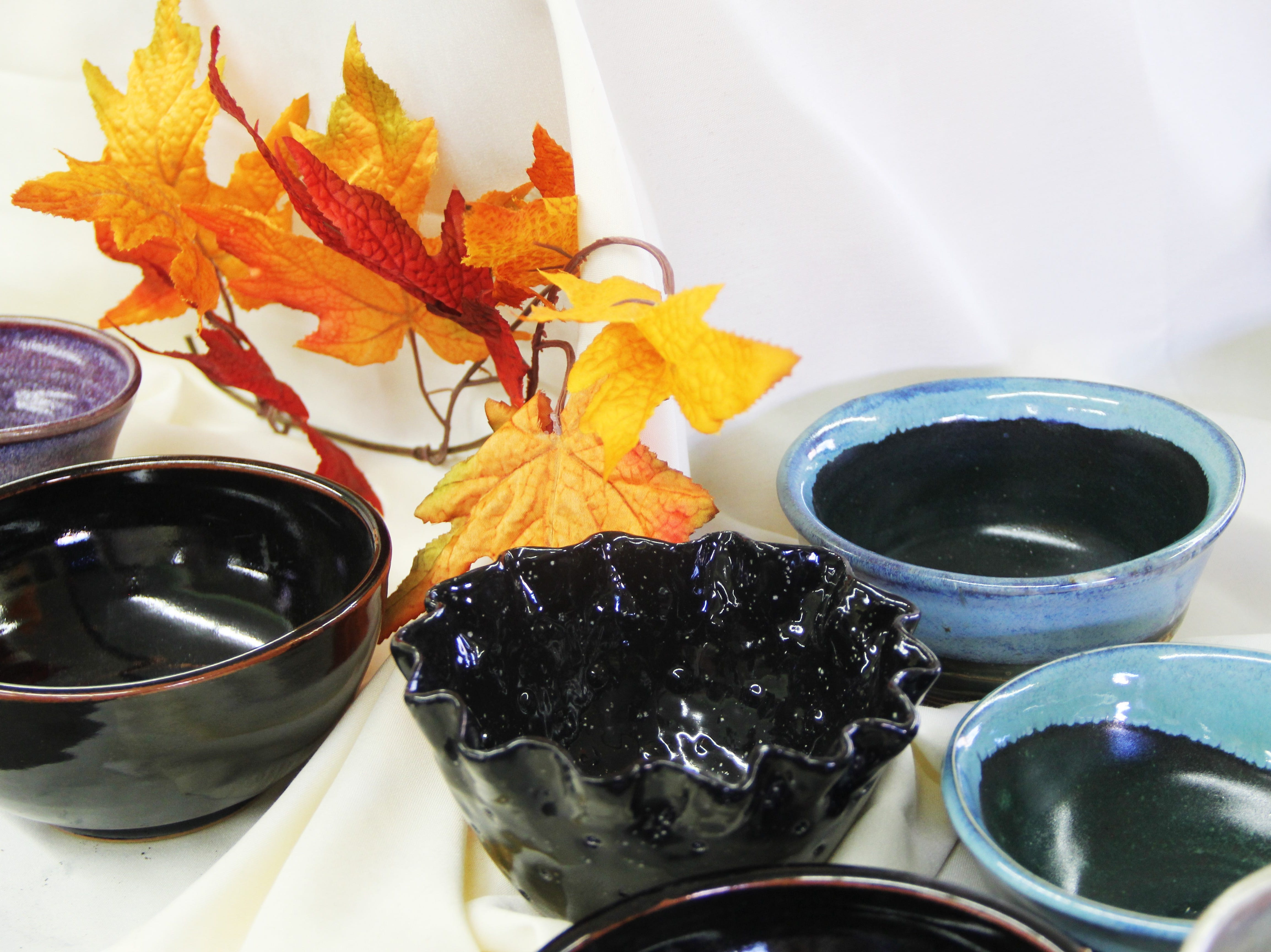 Bowls available at the Willamette Art Center's Empty Bowls fundraiser on Saturday, Nov. 17. Bowls are thrown and glazed by volunteers throughout the year.
