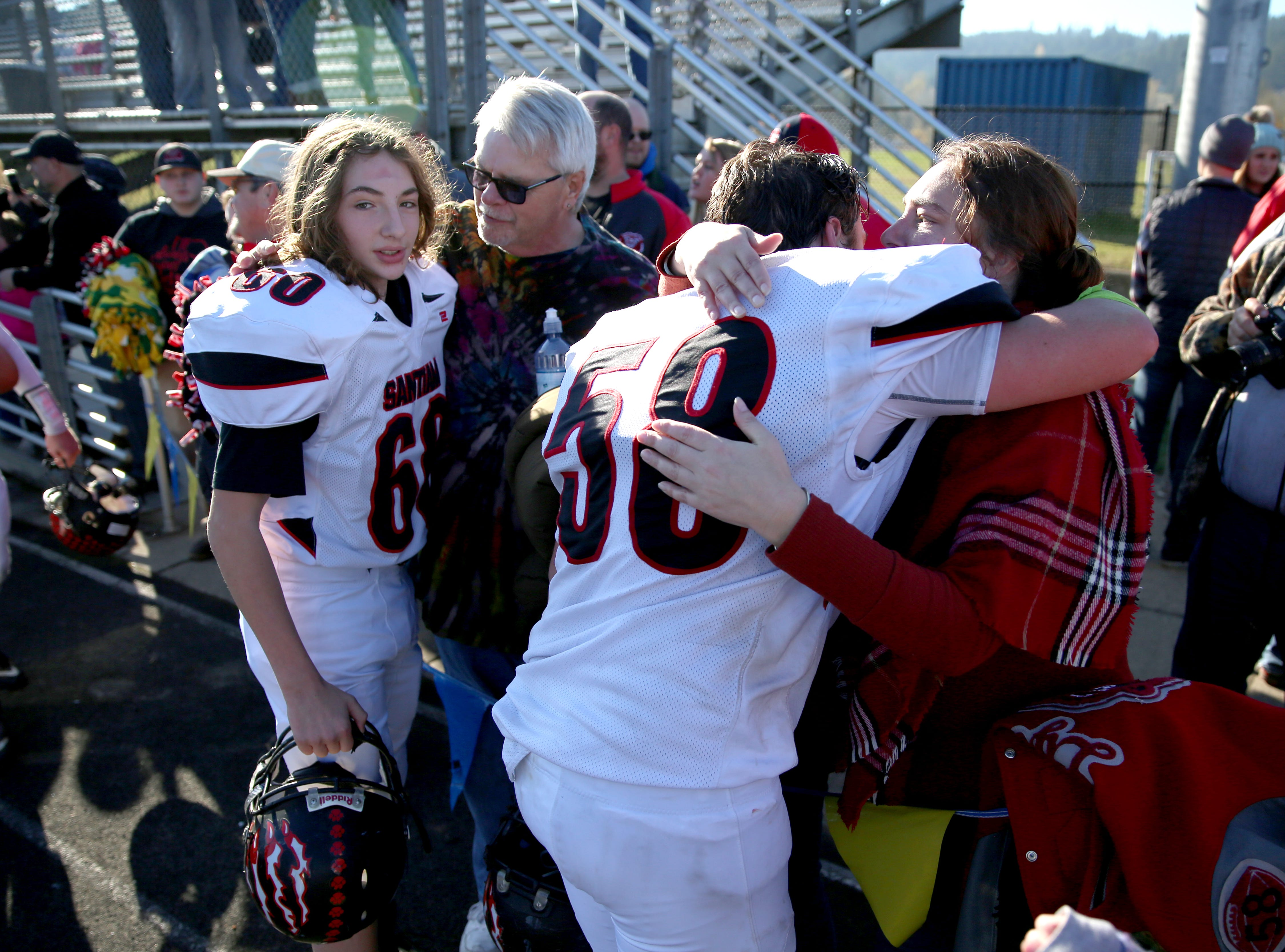 Santiam's Morgan Ruby (60) and Wyatt Lyon (58) greet their family after defeating Monroe, 44-13, in the OSAA 2A semifinal Santiam vs. Monroe football game on Saturday, Nov. 17, 2018 in Cottage Grove.