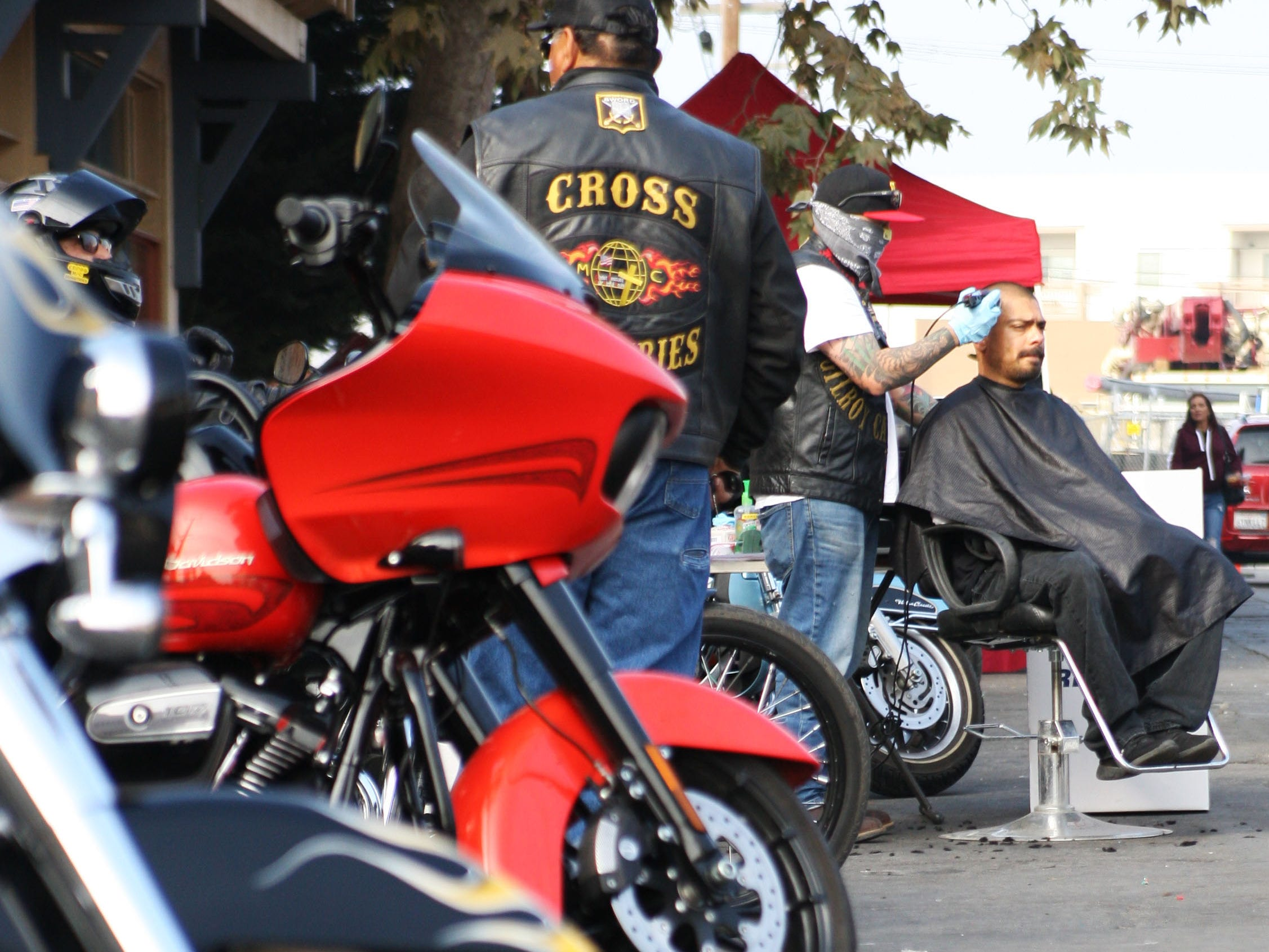 Cross Motorcycle Ministries gave out free haircuts to the homeless and those in need Saturday at the Chinatown block party.