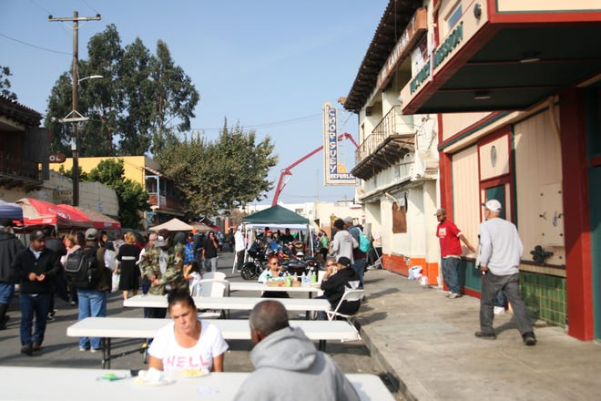 In this file photo, a crowd gathered at a Chinatown block party to support the revitalization efforts and aid the homeless. Gov. Gavin Newsom previewed his 2020-21 state budget on Wednesday, asking lawmakers to earmark more than $1.4 billion to homelessness.