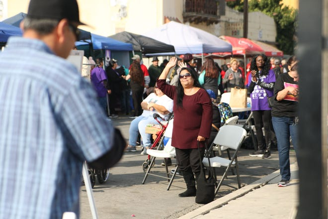 An audience member dances to the band at the Chinatown second annual blockparty.