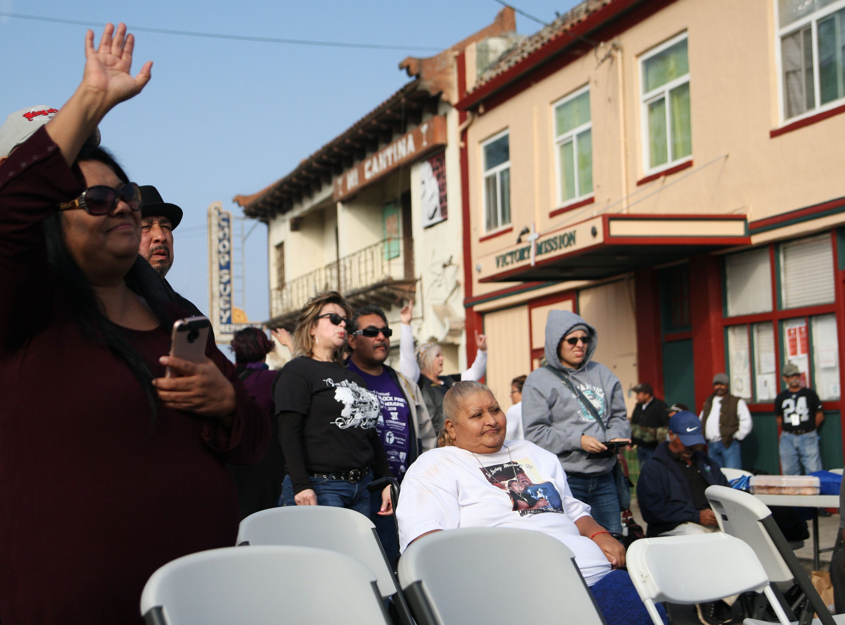 Salinas residents flocked to the Chinatown block party. Many sat and enjoyed the live bands while others raised their hands for Jesus in response to the band's request.