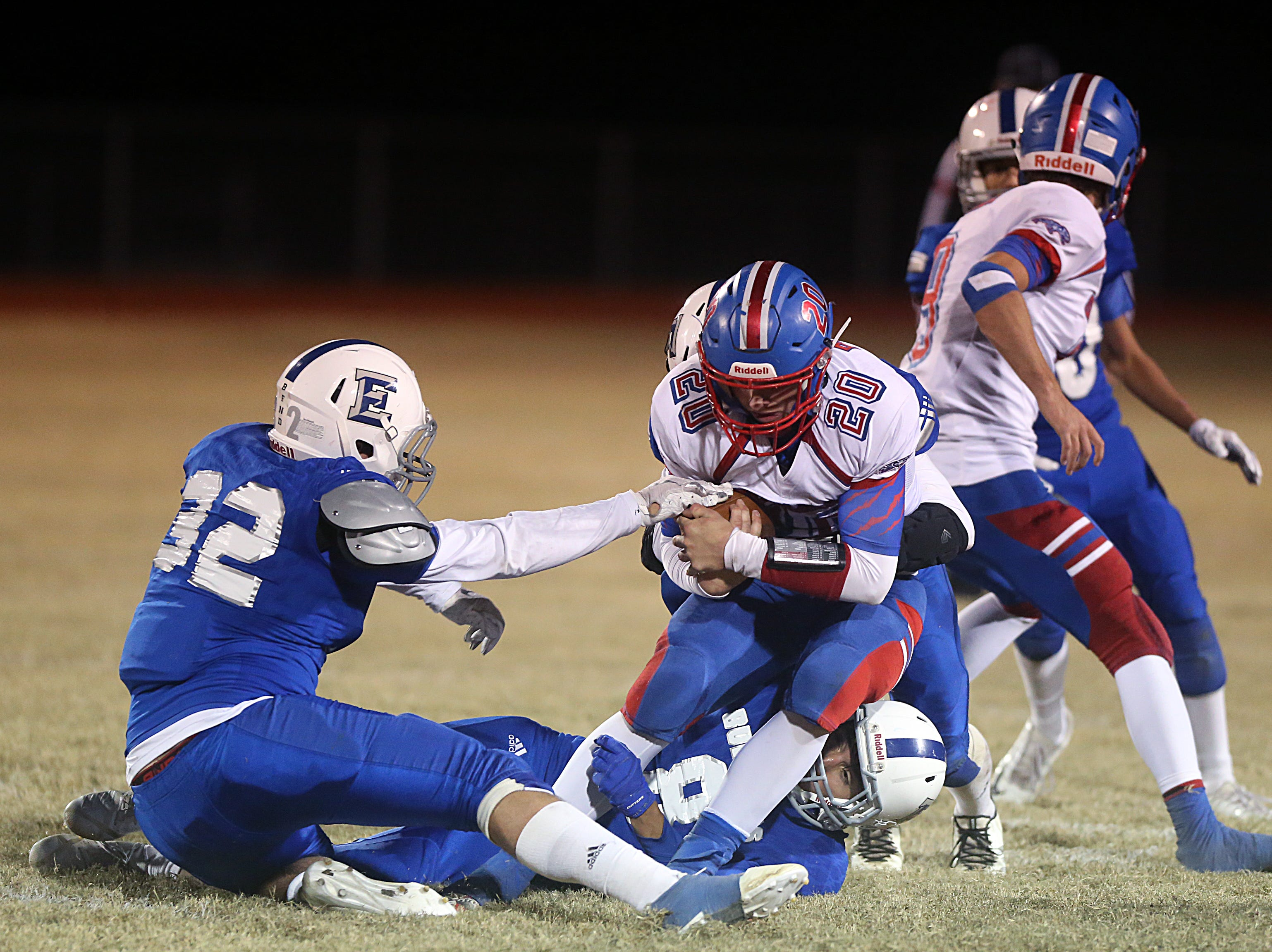 Eden's Erick Pierce (#32) tries to hold on to Gorman's Bryce Petree (#20) Friday, Nov. 16, 2018 during their game in Santa Anna.  Eden lost to Gorman 20 to 68.