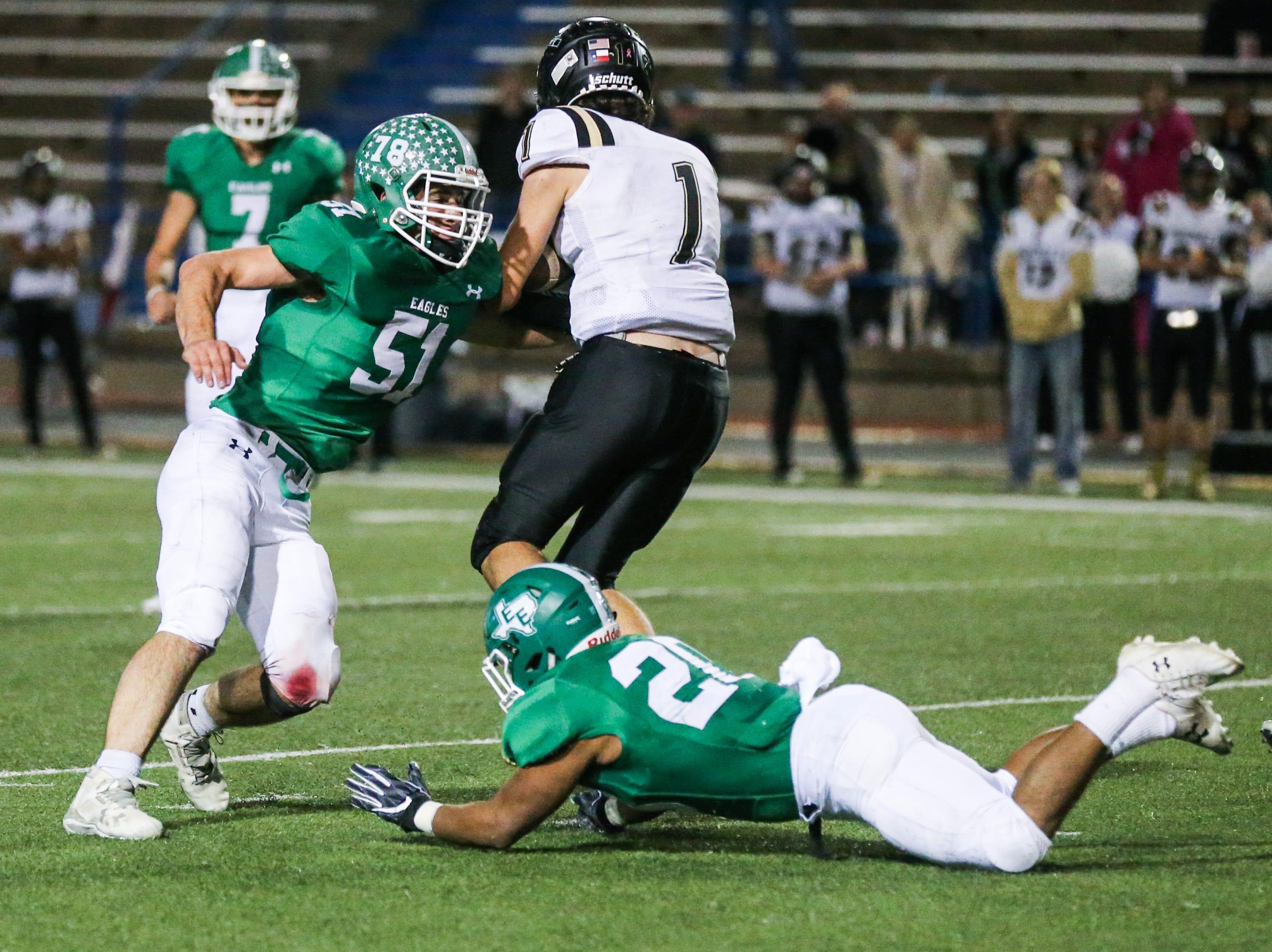 Eldorado defense tackle Haskell ball carrier Friday, Nov. 16, 2018, at San Angelo Stadium.