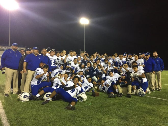 The San Angelo Lake View High School  football team poses with its bidistrict trophy after Friday's 28-21 win over Mountain View in Class 4A Division I playoffs.