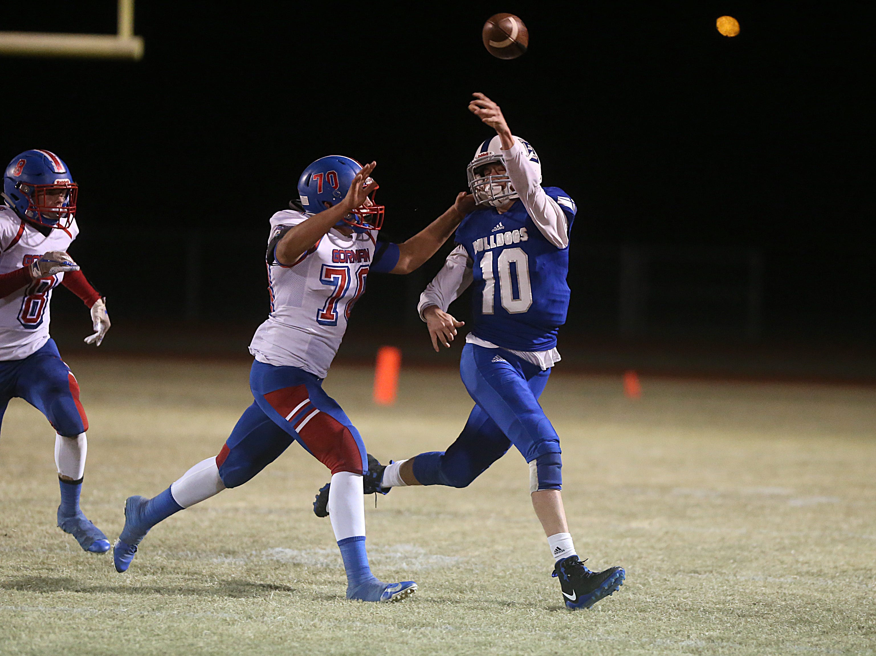 Eden's Hunner Rodgers (#10) throws a last minute pass as Gorman's Cesar Montelongo (#70) attempts to tackle him Friday, Nov. 16, 2018 during their game in Santa Anna. Eden lost to Gorman 20 to 68.