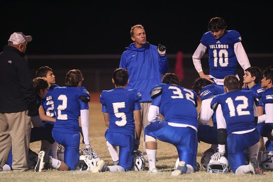 The Eden Bulldogs meet for a talk with their coaches Friday, Nov. 16, 2018 after the game in Santa Anna. Eden lost to Gorman 20 to 68.