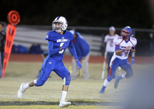 Eden's Ethan Saucedo (#8) watches for a pass Friday, Nov. 16, 2018 during their game against Gorman in Santa Anna. Eden lost to Gorman 20 to 68.