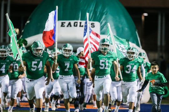 The Eldorado Eagles charge onto the field for their playoff game against Haskell on Friday, Nov. 16, 2018, at San Angelo Stadium.
