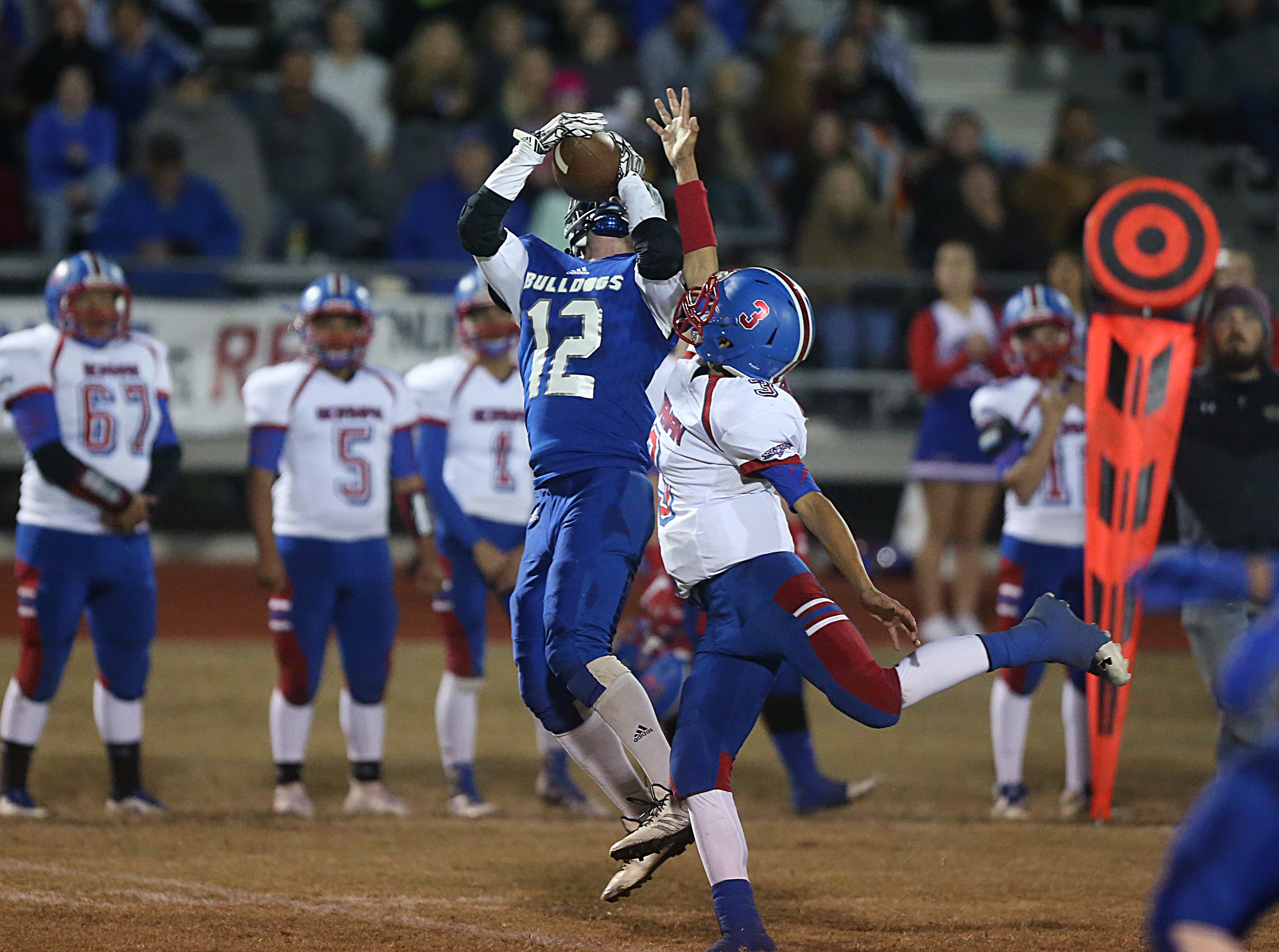 Eden's Anthony Moya (#12) jumps to catch a pass Friday, Nov. 16, 2018 in Santa Anna. Eden lost to Gorman 20 to 68.