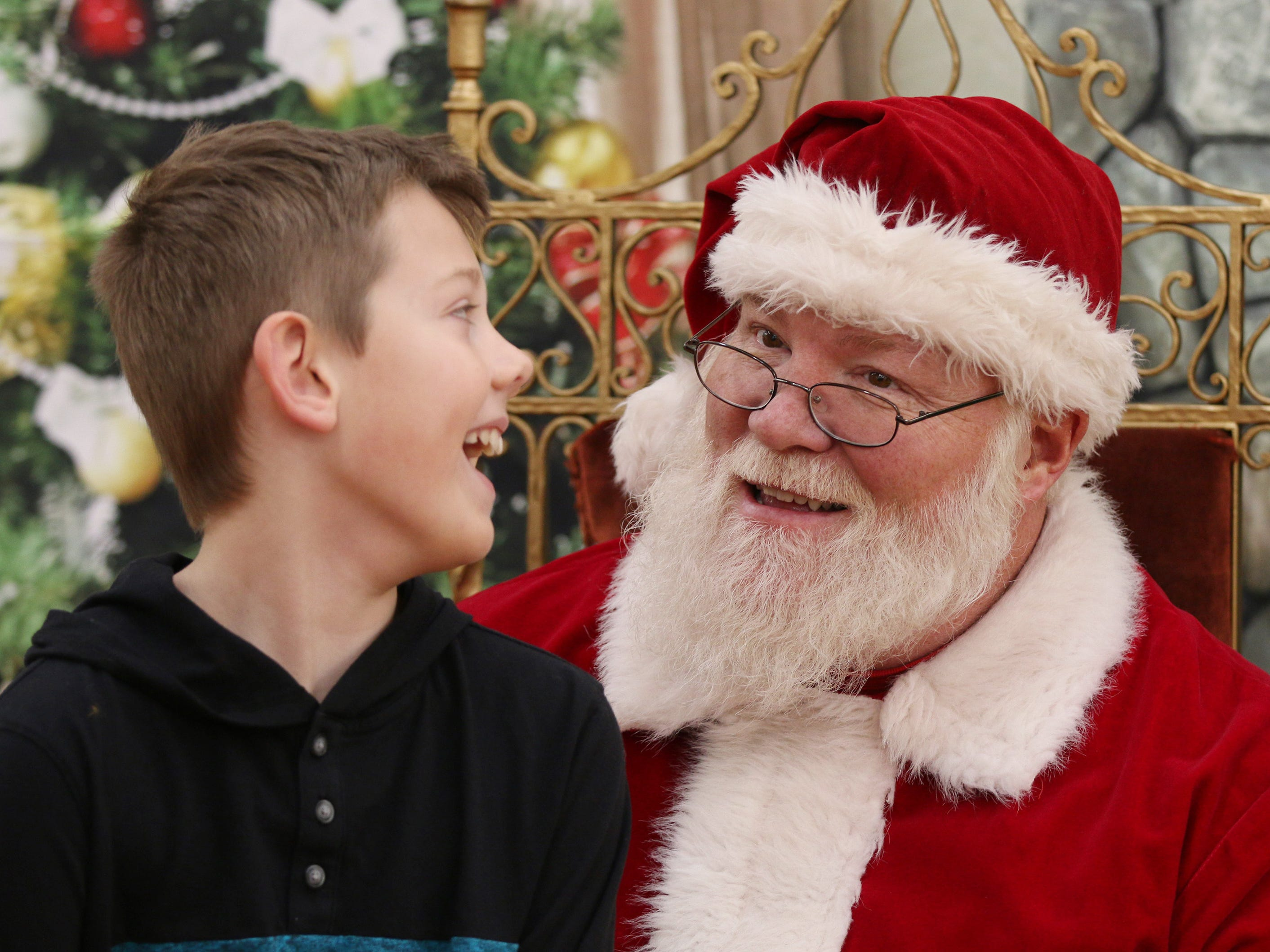 Marcus Rekowski, 8, of Hingham, Wis., share a laugh with Santa Claus at Festival Foods, Saturday November 17, 2018, in Sheboygan, Wis. Santa was part of the Salvation Army's Red Kettle Campaign kickoff.