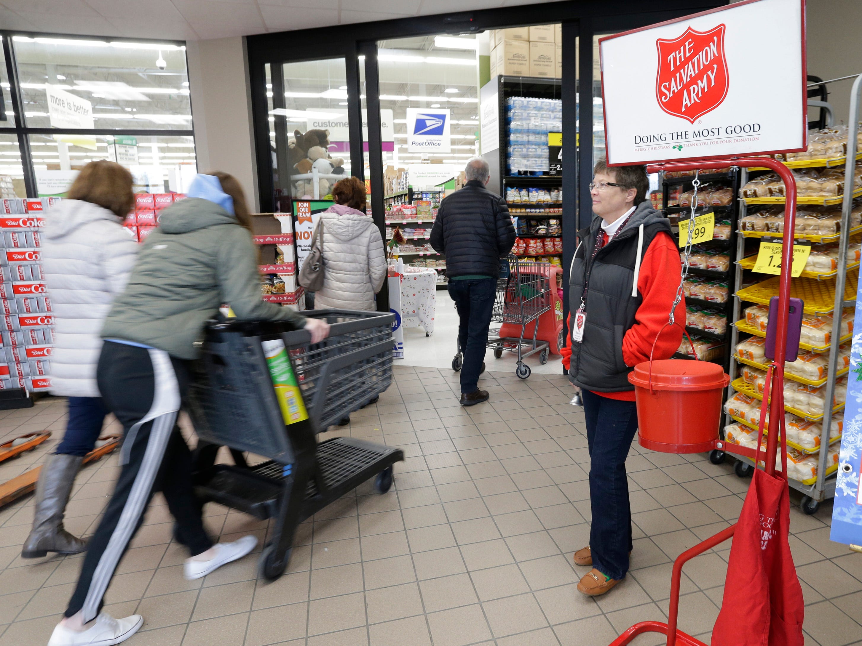 Bell Ringer Fran Schneider, rings for donations for the Salvation Army at Festival Foods, Saturday November 17, 2018, in Sheboygan, Wis.  According to the Army's Captain Daryl Mangeri, they hope to raise 611,000 via kettle proceeds and other fund raising methods for the programs the organization offers.