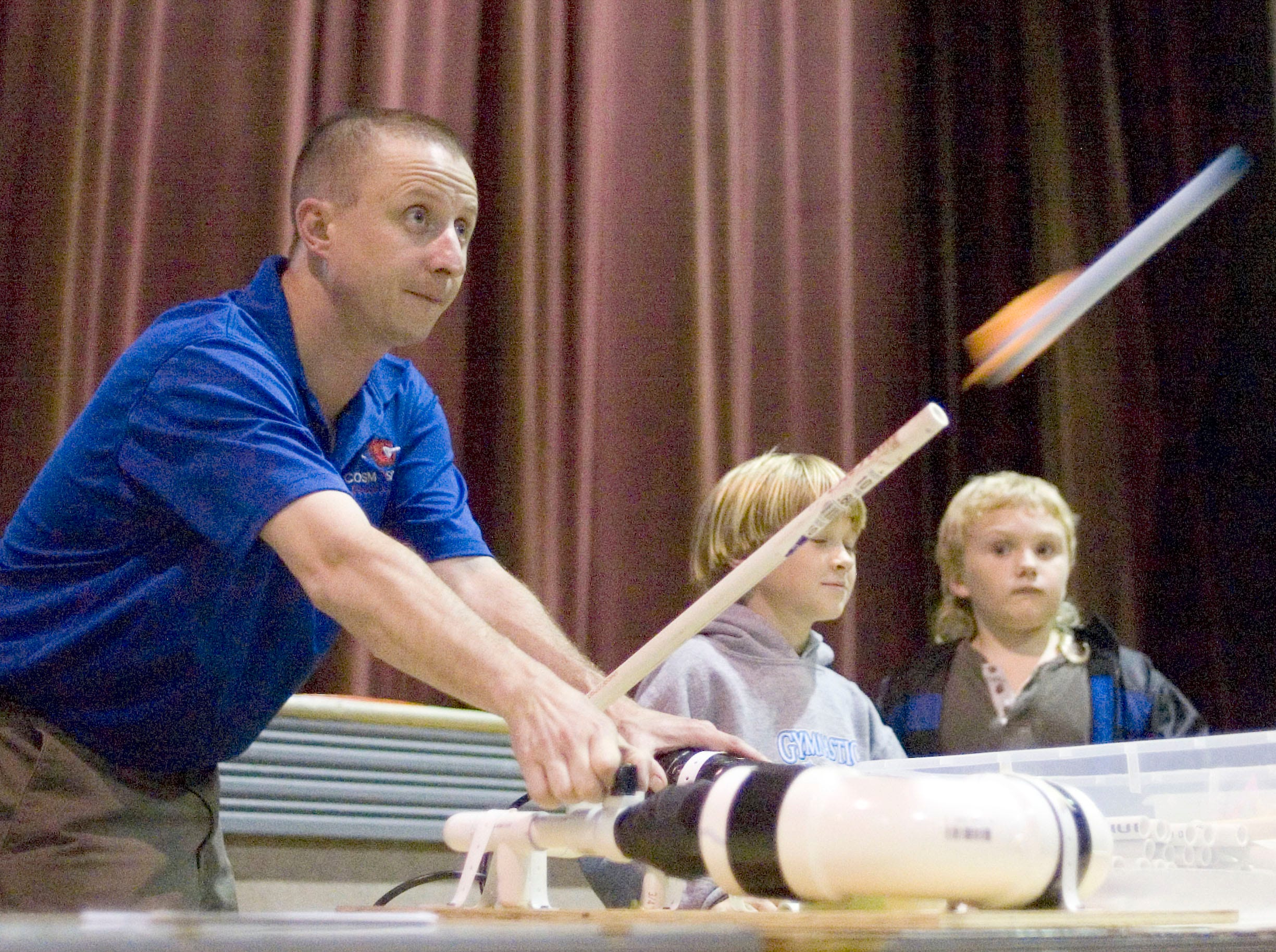 Spaceport Sheboygan's Daniel Bateman launches a rocket of Samson Hou-Seye, 8, right, of Sheboygan Tuesday, October 14, 2008, at Spaceport Sheboygan at the Sheboygan Armory in Sheboygan, Wis.