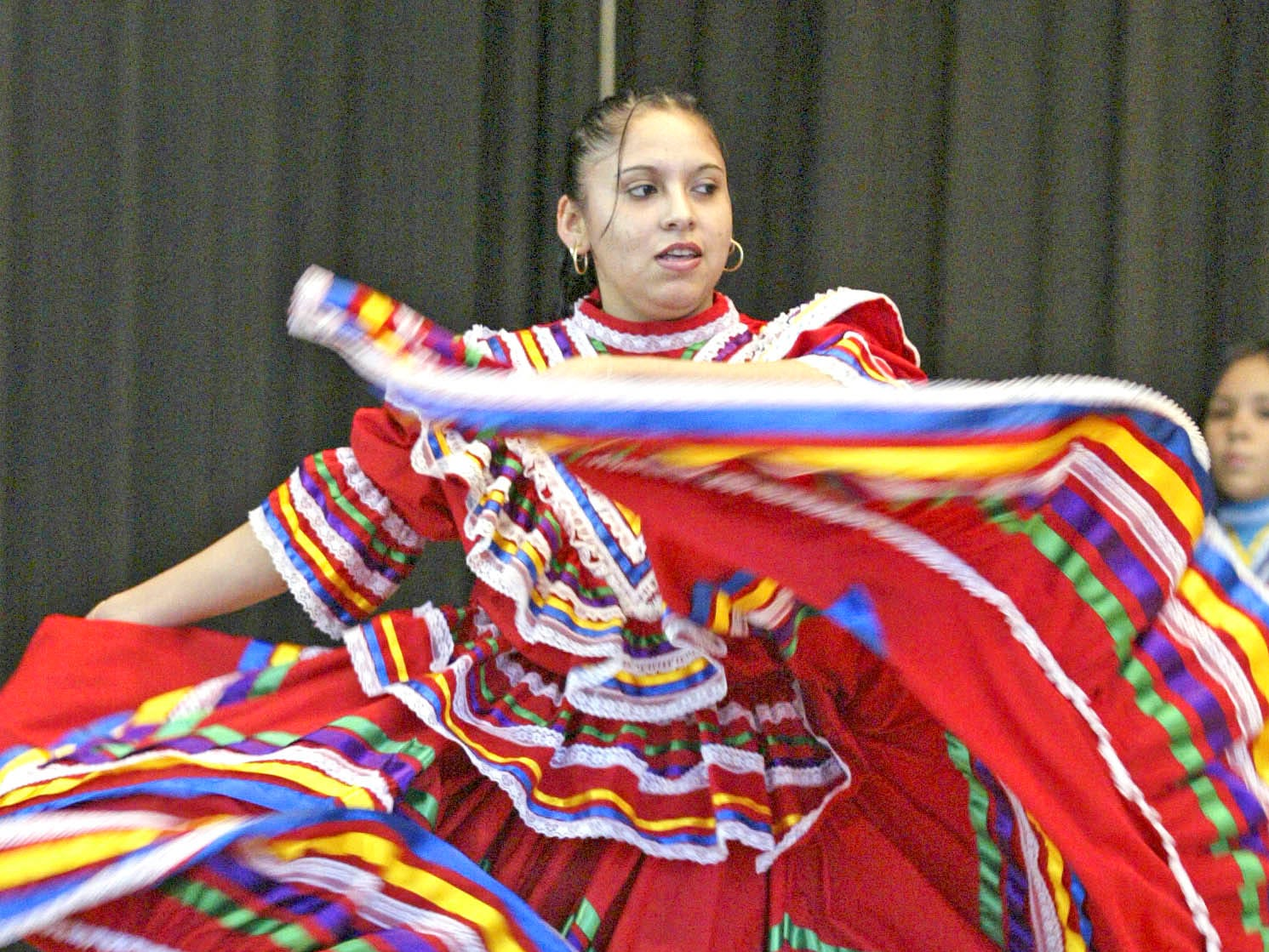 Sheboygan South's Brenda Zagal has her skirt in fluid motion as she dances to a traditional Mexican dance at the second annual Hispanic Information Fair held Sunday, November 5, 2006, at the Sheboygan Armory.  Zagal is a member of the South High School International Dancers troupe.  The event, sponsored by the Sheboygan mayor's office and Lakeshore Technical College, provided information to Hispanic individuals who might not be aware of local community agencies and programs.