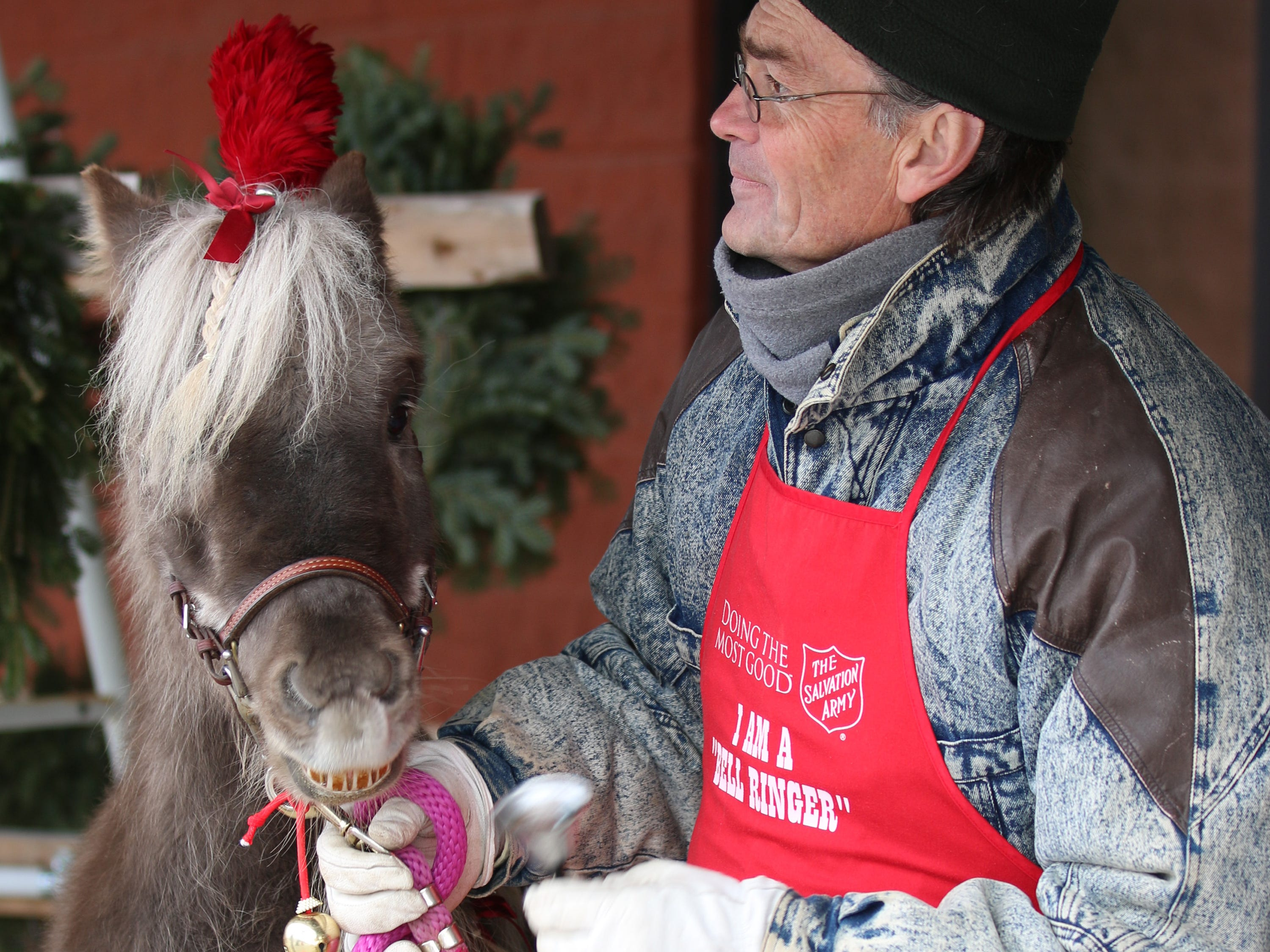 Mini-horse Mr. T and handler Mark Webb ring the bell for the Sheboygan Salvation Army, Saturday November 17, 2018, in Sheboygan, Wis. The horse and Webb was part of the Salvation Army's Red Kettle Campaign kickoff.