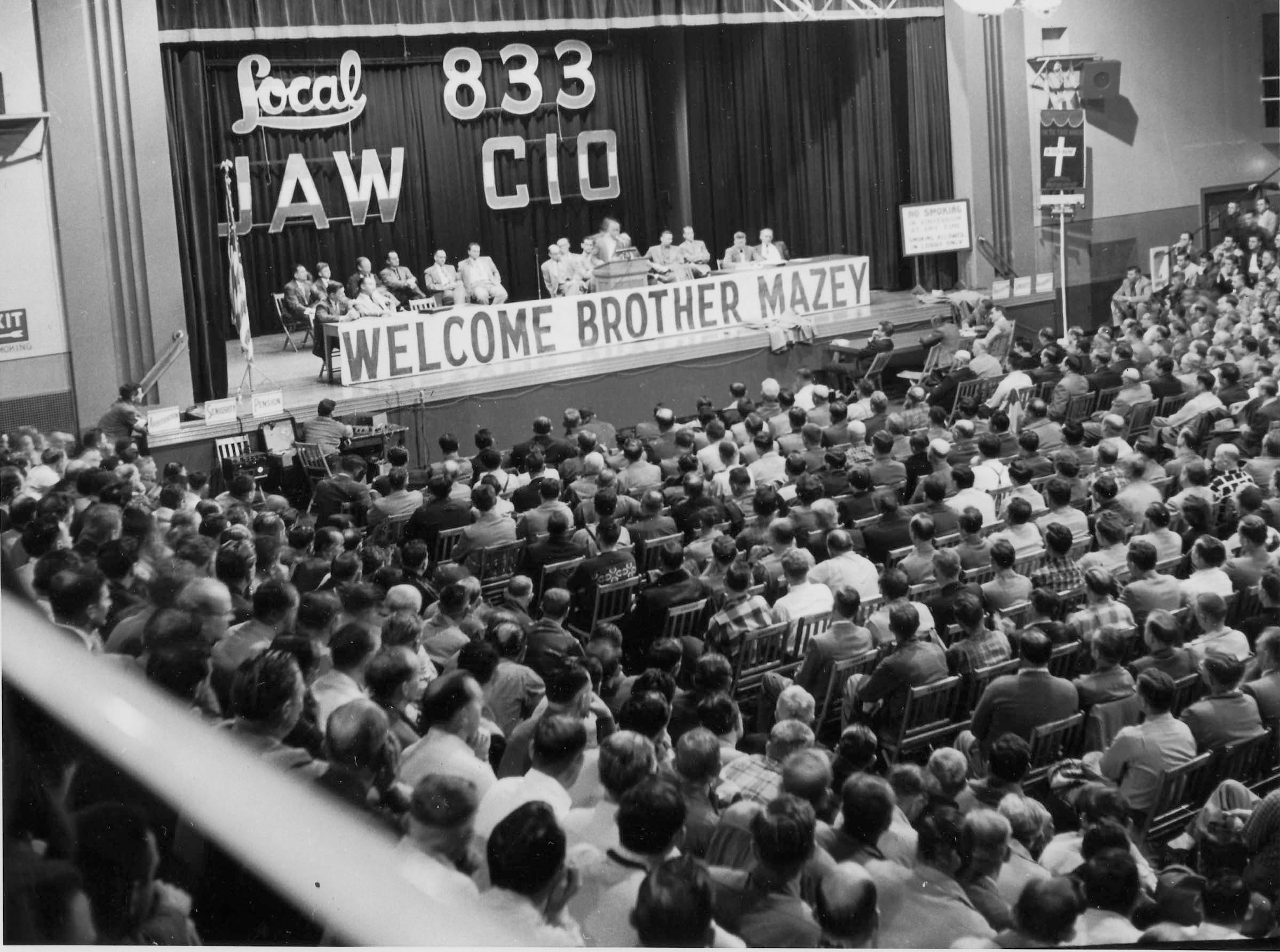 Emil  Mazy, secretary-treasurer of the UAW-CIO was the principal speaker at a meeting of Local 833 at the Sheboygan Armory Wednesday evening November 17, 1954.  The view is towards the stage while  Allan Graskamp, president of Local 833 was addressing union members.