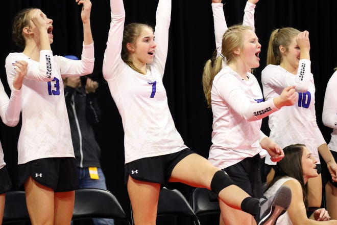 Members of the Sioux Falls Christian bench cheer during the match with McCook Central-Montrose during Friday's Class A semifinal in Sioux Falls.